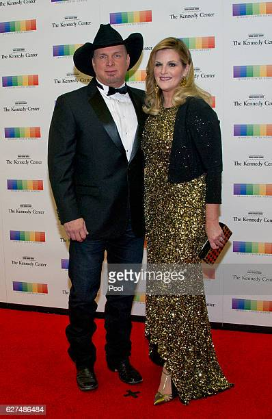 Garth Brooks and Tricia Yearwood arrive for the formal Artist's Dinner honoring the recipients of the 39th Annual Kennedy Center Honors hosted by...