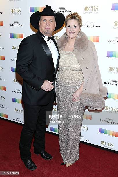 Garth Brooks and Trisha Yearwood arrive at the 39th Annual Kennedy Center Honors at The Kennedy Center on December 4 2016 in Washington DC