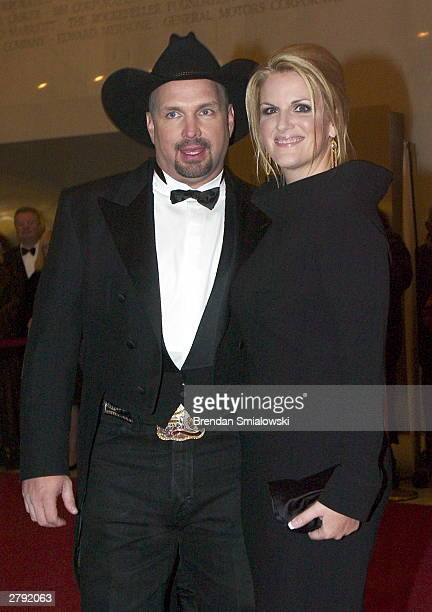 Garth Brooks and Trisha Yearwood arrive at the Kennedy Center Honors December 7 2003 in Washington DC