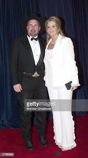 Garth Brooks and Trisha Yearwood arrive at the United States State Department for a dinner in Washington Saturday December 6 2003 evening preceding...