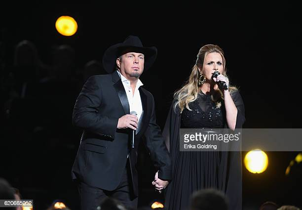 Garth Brooks and Trisha Yearwood perform onstage at the 50th annual CMA Awards at the Bridgestone Arena on November 2 2016 in Nashville Tennessee