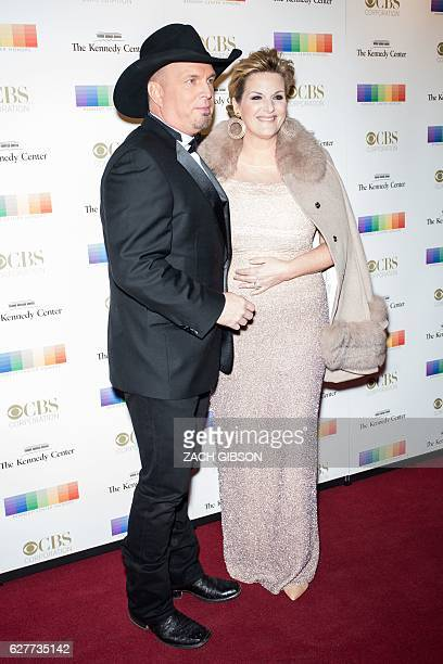 Garth Brooks and Trisha Yearwood pose on the red carpet before the 39th Annual Kennedy Center Honors December 4 2019 in Washington DC / AFP / ZACH...