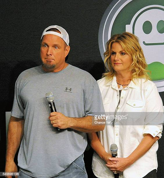 Garth Brooks and Trisha Yearwood speak during press conference at Yankee Stadium on July 8 2016 in New York City