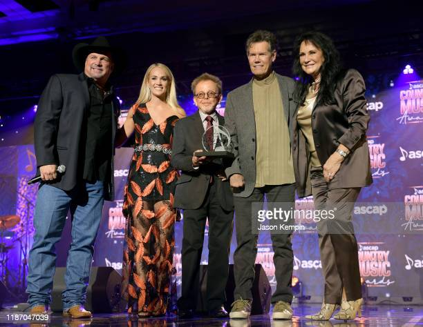 Garth Brooks Carrie Underwood Paul Williams Randy Travis and Mary Davis seen onstage during the 57th Annual ASCAP Country Music Awards on November 11...