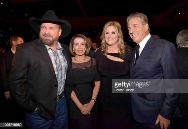 Garth Brooks Nancy Pelosi Trisha Yearwood and Paul Pelosi attend MusiCares Person of the Year honoring Dolly Parton at Los Angeles Convention Center...