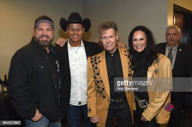Garth Brooks Neal McCoy Randy Travis and Mary Travis pose backstage during 1 Night 1 Place 1 Time A Heroes Friends Tribute to Randy Travis at...