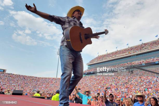 Garth Brooks performs during the Oklahoma Twister Relief Concert to benefit United Way of Central Oklahoma May Tornadoes Relief Fund at Gaylord...