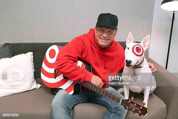 Garth Brooks poses in his green room with Bullseye the dog during the Target Corporation Fall National Meeting at Target Center on September 15 2016...