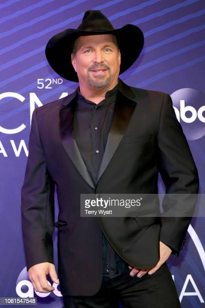 Garth Brooks poses in the press room at the 52nd annual CMA Awards at the Bridgestone Arena on November 14 2018 in Nashville Tennessee