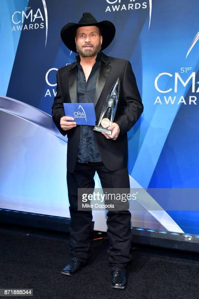 Garth Brooks poses with Entertainer of the year award in the press room at the 51st annual CMA Awards at the Bridgestone Arena on November 8 2017 in...