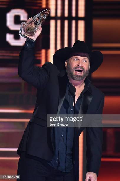 Garth Brooks wins Entertainer of the year onstage at the 51st annual CMA Awards at the Bridgestone Arena on November 8 2017 in Nashville Tennessee