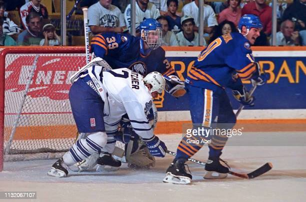 Garth Butcher of the Toronto Maple Leafs skates against Dale Hawerchuk and Dominik Hasak of the Buffalo Sabres during NHL preseason game action on...