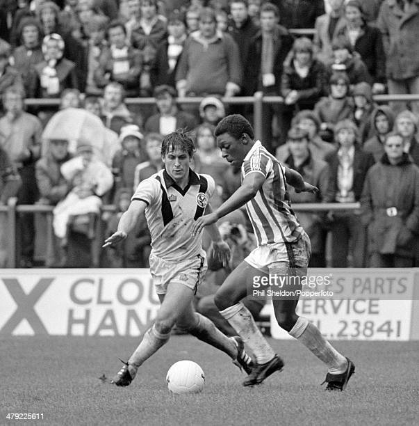 Garth Crooks of Stoke City is challenged by Crystal Palace defender Kenny Sansom during their Second Division match at the Victoria Ground in...