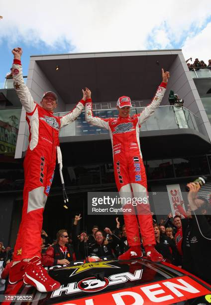 Garth Tander and Nick Percat drivers of the Toll Holden Racing Team Holden celebrate after winning the Bathurst 1000 which is round 10 of the V8...