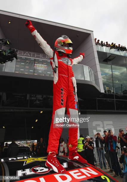 Garth Tander driver of the Toll Holden Racing Team Holden celebrates after winning the Bathurst 1000 which is round 10 of the V8 Supercars...