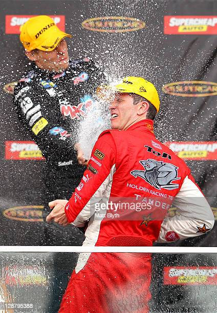 Garth Tander driver of the Toll Holden Racing Team Holden celebrates on the podium after winning the Bathurst 1000 which is round 10 of the V8...