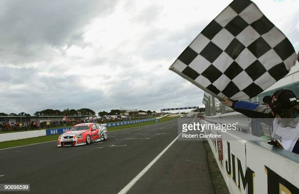Garth Tander driving the Holden Racing Team Holden crosses the line to win race 17 for round nine of the V8 Supercar Championship Series at the...