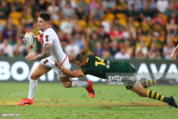 Garth Widdop of England is tackled by Wade Graham of Australia during the 2017 Rugby League World Cup Final between the Australian Kangaroos and...