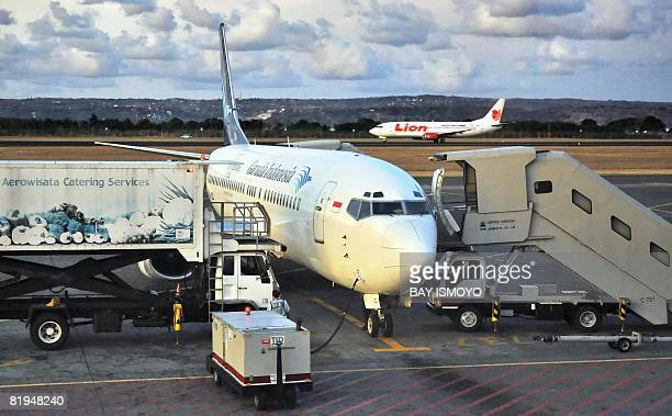 A Garuda airlines plane is parked at the tarmac of the airport in Denpasar Bali island on July 16 2008 European Union banned all Indonesianregistered...