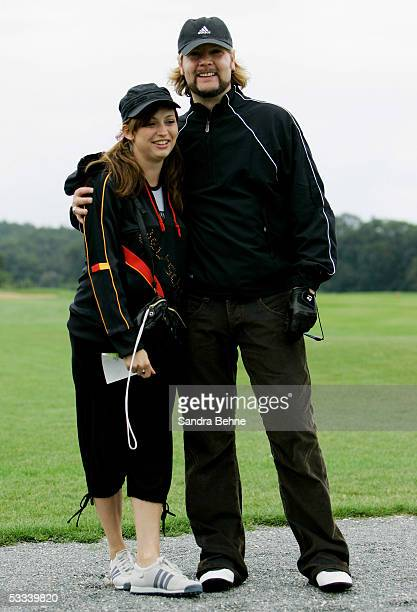 Garvey Rea singer of the band Reamon poses with his pregnant wife Josephine during the Adidas Golf Tournament at the golf club Herzogenaurach August...