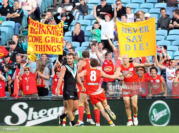 Gary Ablet of the suns celebrates with team mate Luke Russell after Russell scored a goal to put the Gold Coast in the lead during the round five AFL...