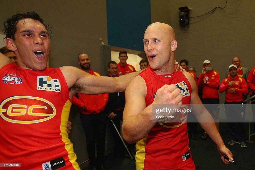 Gary Ablett and Harley Bennell of the Suns sing the team song after winning during the round 17 AFL match between the Gold Coast Suns and the Collingwood Magpies at Metricon Stadium on July 20, 2013 in Gold Coast, Australia.
