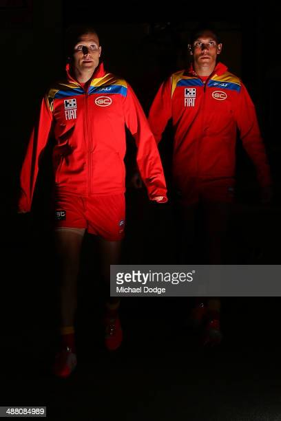Gary Ablett and Harley Bennell of the Suns walk up the race during the round seven AFL match between the North Melbourne Kangaroos and the Gold Coast...