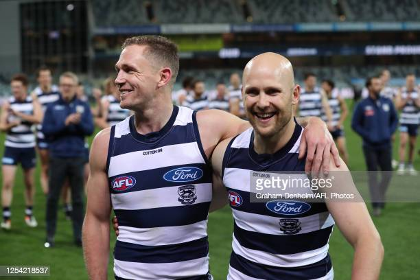 Gary Ablett and Joel Selwood of the Cats leave the field following victory in the round 5 AFL match between the Geelong Cats and the Gold Coast Suns...