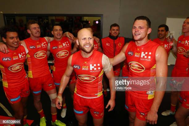 Gary Ablett and Steven May of the the Suns sing the team song after winning the round 15 the Gold Coast Suns and the North Melbourne Kangaroos at...