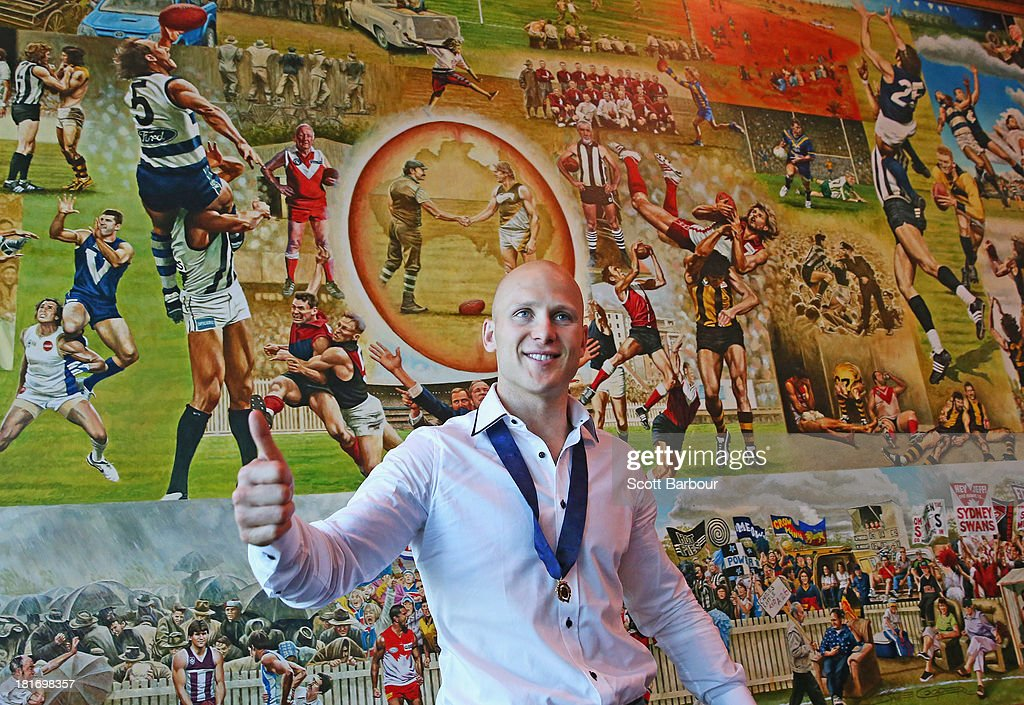 Gary Ablett Jnr of the Gold Coast Suns poses with the Brownlow medal at AFL House on September 24, 2013 in Melbourne, Australia. Ablett won the 2013 AFL Brownlow medal last night.