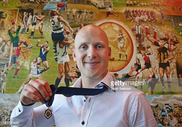 Gary Ablett Jnr of the Gold Coast Suns poses with the Brownlow medal at AFL House on September 24, 2013 in Melbourne, Australia. Ablett won the 2013...