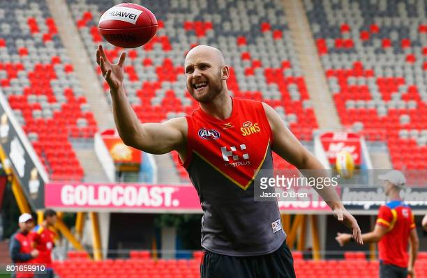 Gary Ablett juggles the ball during a Gold Coast Suns AFL training session at Metricon Stadium on June 27 2017 in Gold Coast Australia