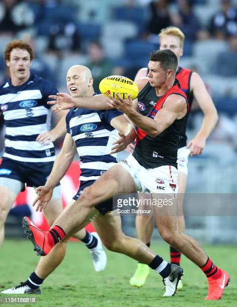 Gary Ablett of the Cats and Conor McKenna of the Bombers compete for the ball during the 2019 JLT Community Series AFL match between the Geelong Cats...