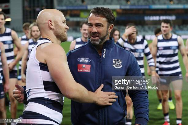 Gary Ablett of the Cats and Geelong Cats Head Coach Chris Scott embrace following victory in the round 5 AFL match between the Geelong Cats and the...