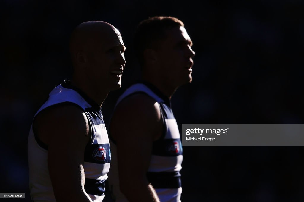 Gary Ablett of the Cats (L) and Joel Selwood look upfield during the round two AFL match between the Geelong Cats and the Hawthorn Hawks at Melbourne Cricket Ground on April 2, 2018 in Melbourne, Australia.