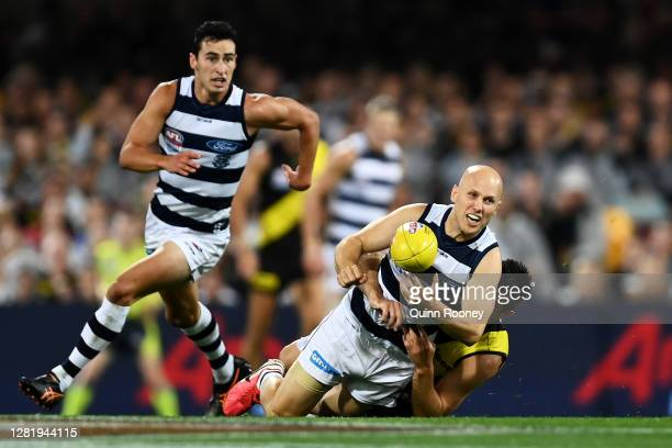 Gary Ablett of the Cats is tackled by Trent Cotchin of the Tigers during the 2020 AFL Grand Final match between the Richmond Tigers and the Geelong...