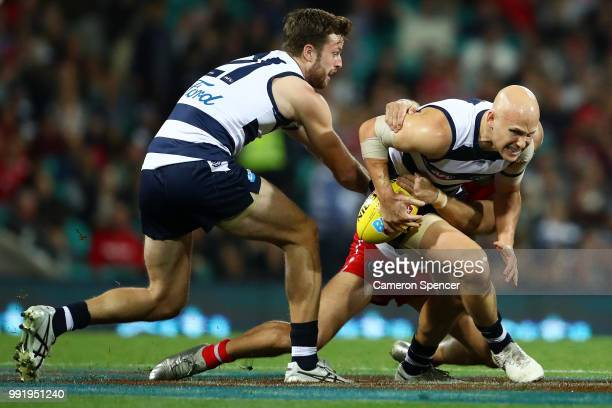 Gary Ablett of the Cats is tackled during the round 16 AFL match between the Sydney Swans and the Geelong Cats at Sydney Cricket Ground on July 5...