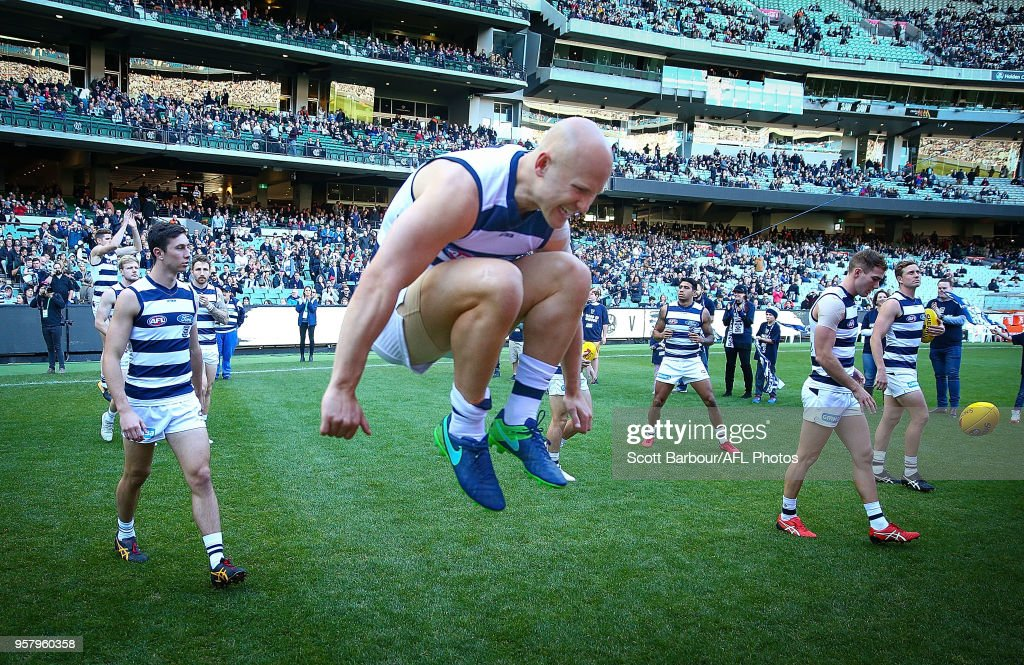 Gary Ablett of the Cats jumps in the air as they run through their banner and onto the field during the round eight AFL match between the Collingwood Magpies and the Geelong Cats at Melbourne Cricket Ground on May 13, 2018 in Melbourne, Australia.