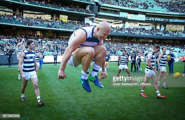 Gary Ablett of the Cats jumps in the air as they run through their banner and onto the field during the round eight AFL match between the Collingwood...