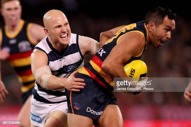 Gary Ablett of the Cats tackles Eddie Betts of the Crows during the 2018 AFL round 17 match between the Adelaide Crows and the Geelong Cats at...