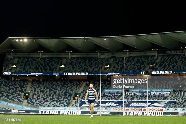 Gary Ablett of the Cats walks off the ground after playing his 350th game in front of no fans after the round 5 AFL match between the Geelong Cats...