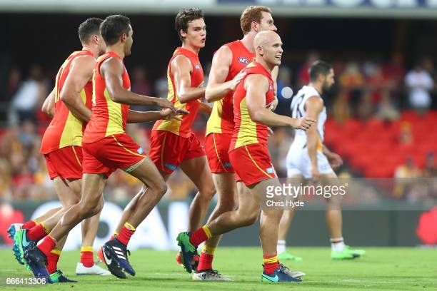 Gary Ablett of the Suns celebrates a goal during the round three AFL match between the Gold Coast Suns and the Hawthorn Hawks at Metricon Stadium on...