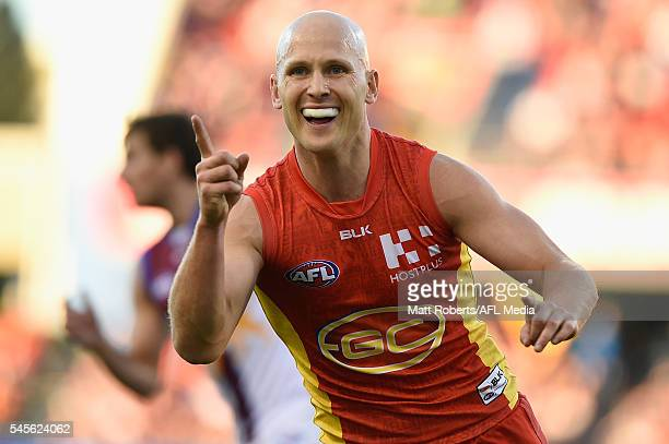 Gary Ablett of the Suns celebrates kicking a goal during the round 16 AFL match between the Gold Coast Suns and the Brisbane Lions at Metricon...