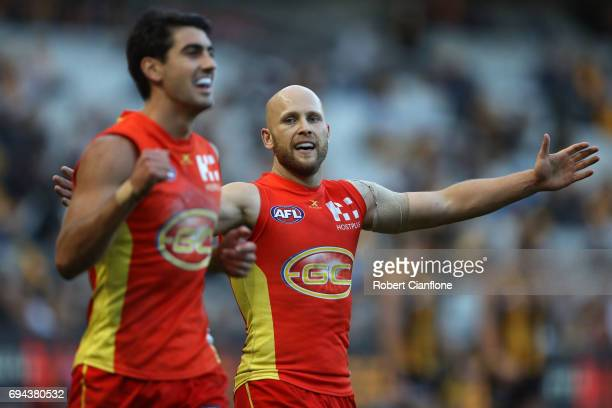 Gary Ablett of the Suns celebrates on the siren after the Suns defeated the Hawks during the round 12 AFL match between the Hawthorn Hawks and the...
