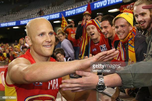 Gary Ablett of the Suns celebrates the win with fans during the round seven AFL match between the North Melbourne Kangaroos and the Gold Coast Suns...