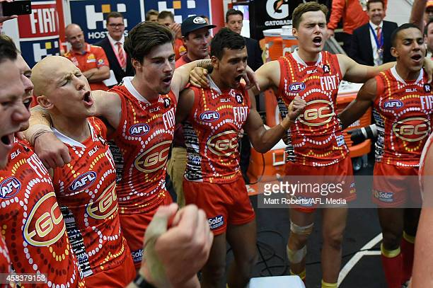 Gary Ablett of the Suns celebrates with team mates after the round 15 AFL match between the Gold Coast Suns and the St Kilda Saints at Metricon...