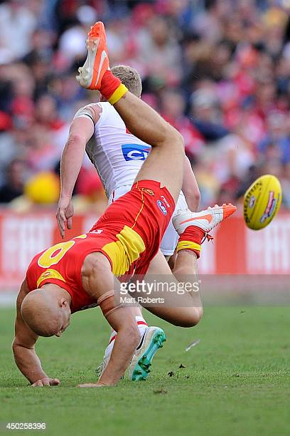Gary Ablett of the Suns competes for the ball with Dan Hannebery of the Swans during the round 12 AFL match between the Gold Coast Suns and Sydney...