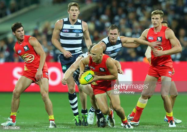Gary Ablett of the Suns gets a clearance out of the centre during the round ten AFL match between the Geelong Cats and the Gold Coast Suns at Simonds...