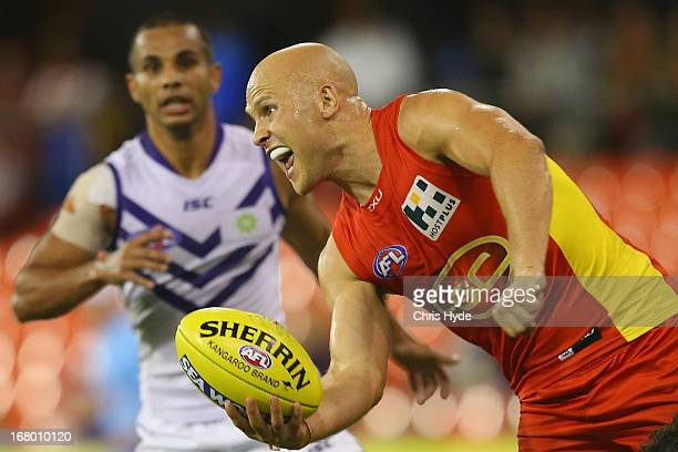 Gary Ablett of the Suns handballs during the round six AFL match between the Gold Coast Suns and the Fremantle Dockers at Metricon Stadium on May 4...