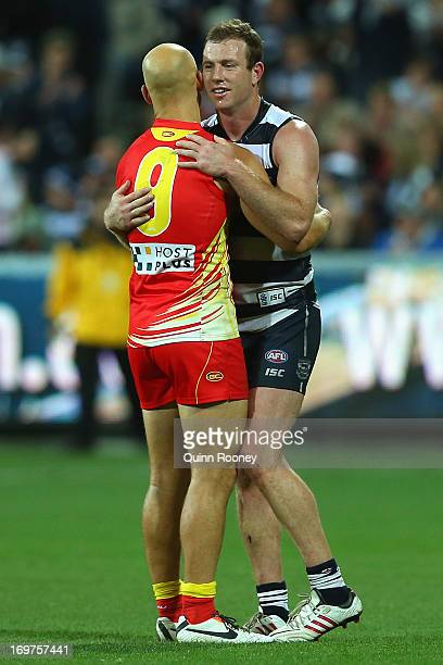 Gary Ablett of the Suns hugs Steve Johnson of the Cats at the end of the round ten AFL match between the Geelong Cats and the Gold Coast Suns at...